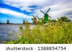 Windmill Farm River In Holland...