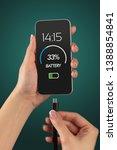 elegant hand charging cellphone ... | Shutterstock . vector #1388854841