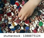 kids hand playing with buttons... | Shutterstock . vector #1388875124