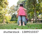 asian mother and her daughters... | Shutterstock . vector #1389010337