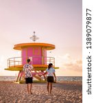 couple on the beach at miami... | Shutterstock . vector #1389079877