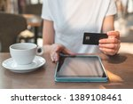 female using tablet computer...   Shutterstock . vector #1389108461