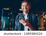 funny caucasian male in casual... | Shutterstock . vector #1389384224