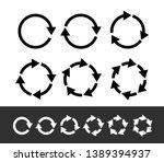 set of black circle arrows.... | Shutterstock .eps vector #1389394937
