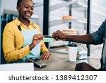 adult african american barista... | Shutterstock . vector #1389412307