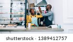 cheerful black man and woman in ... | Shutterstock . vector #1389412757