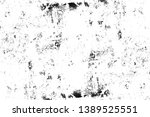black and white distressed... | Shutterstock . vector #1389525551