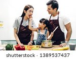 happy family father and mother... | Shutterstock . vector #1389537437