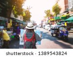rear view of a young asian... | Shutterstock . vector #1389543824