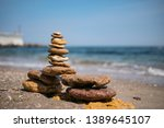 cairn on sea background. pyramid | Shutterstock . vector #1389645107