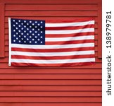 American Flag Displayed On Red...