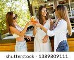 three pretty young women... | Shutterstock . vector #1389809111