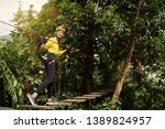 young woman with climbing gear... | Shutterstock . vector #1389824957