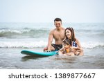 happy asian family on beach ... | Shutterstock . vector #1389877667