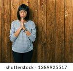 beautiful young african... | Shutterstock . vector #1389925517