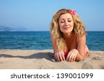 attractive woman on a seacoast | Shutterstock . vector #139001099
