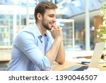 portrait of young man sitting... | Shutterstock . vector #1390046507