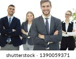 businessman with colleagues in... | Shutterstock . vector #1390059371