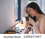 young asia woman sitting enjoy... | Shutterstock . vector #1390077497