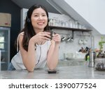 happy asia woman enjoy drinking ... | Shutterstock . vector #1390077524