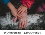 senior and kids hands in nature ... | Shutterstock . vector #1390094597