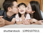 asian parents kissing their... | Shutterstock . vector #1390107011
