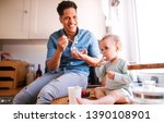 a father and a small toddler...   Shutterstock . vector #1390108901