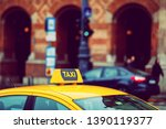 taxi cab detail and blurred... | Shutterstock . vector #1390119377