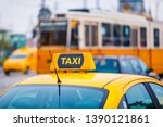 yellow taxi car and blurred... | Shutterstock . vector #1390121861