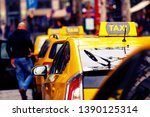 yellow taxi cars in row and... | Shutterstock . vector #1390125314