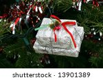 small wrapped presents in musical paper ornament - stock photo