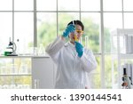 scientists women research and... | Shutterstock . vector #1390144541