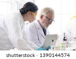 male and female scientists are... | Shutterstock . vector #1390144574