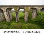 Small photo of Chirk Aqueduct carries the Llangollen Canal across the Ceiriog Valley near Chirk, on the England-Wales border, spanning the two countries.