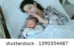 mother and baby together after... | Shutterstock . vector #1390354487