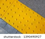 tactile paving. dot sign on the ... | Shutterstock . vector #1390490927