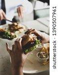 girl holding a burger. teen... | Shutterstock . vector #1390507961