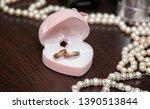 wedding rings in a heart box | Shutterstock . vector #1390513844