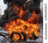 burning automobile tires ... | Shutterstock . vector #1390690547