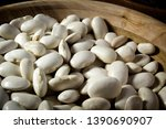 beans in a wooden plate on the... | Shutterstock . vector #1390690907