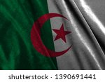 algeria flag on silver fabric.... | Shutterstock . vector #1390691441