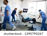 Blurred View Of Dentists And...