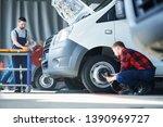one of young car service... | Shutterstock . vector #1390969727