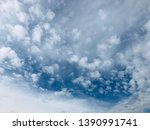 white overcasts clouds sky... | Shutterstock . vector #1390991741