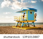 couple on the beach at miami... | Shutterstock . vector #1391013887