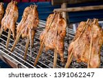 ripe grilled chickens with... | Shutterstock . vector #1391062247
