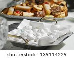 Sweet white wedding dragee composition on the table. - stock photo