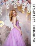 elegant bride in a long lush... | Shutterstock . vector #1391154164