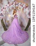 elegant bride in a long lush... | Shutterstock . vector #1391154167