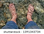 feet immersed in the clear... | Shutterstock . vector #1391343734